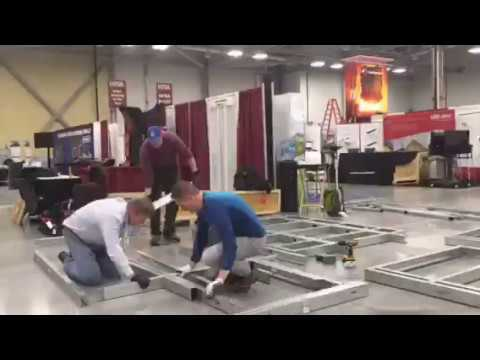 three men building a steel Keymark pole barn